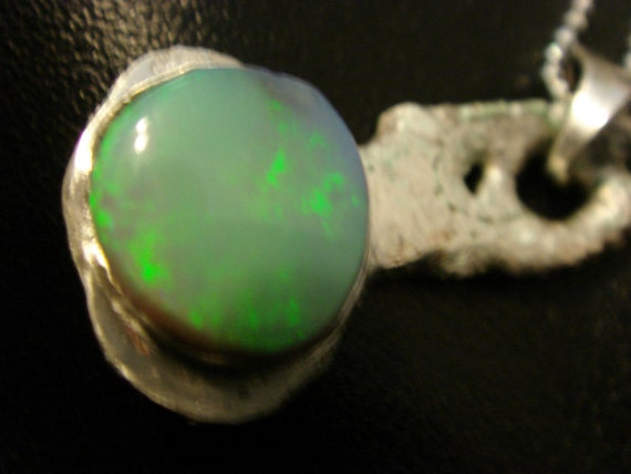 The Stone   Lightning Ridge Black Opal  silver pendant