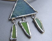 Choker with soldered green glass pendant.