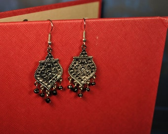 Silver filigree earrings with black beaded accents