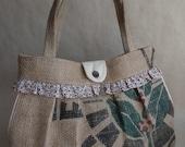 Upcycled pleated burlap shoulder bag. Side pockets. Red blue tan floral.