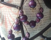 Retro purple pierced earrings