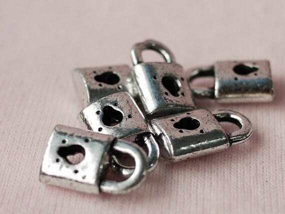 10 Pcs. Little Master Key Plastic Pendant (Silver Coted) 10 mm.