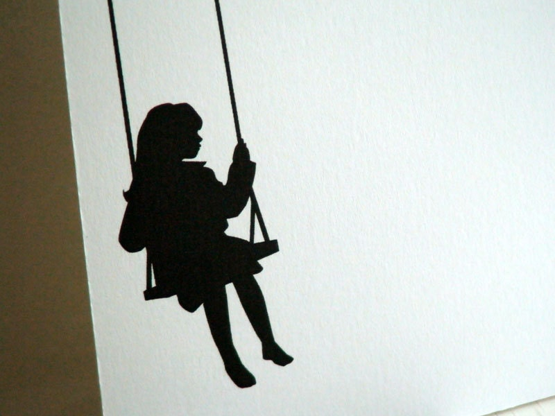 Girl And Cat Sihouette Sitting On A Swing
