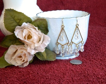 Crystal clear glass chandelier and gold toned earrings