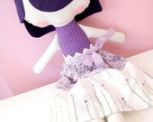 art doll with hand embroidered hair and skirt in violet