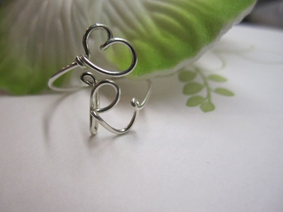 Reserved listing for Ashley....4 rings...adjustable personalized hand twisted heart and initial ring in sterling silver