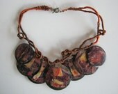 shell discs art handmade collage paper wrapped cord ethnic tribal amulet talisman pendants