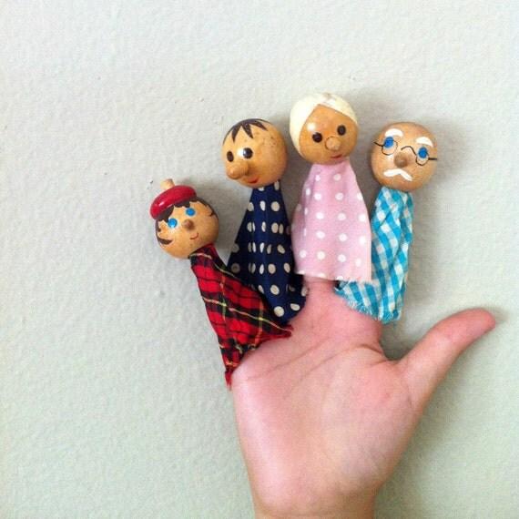 4 vintage wooden finger puppets