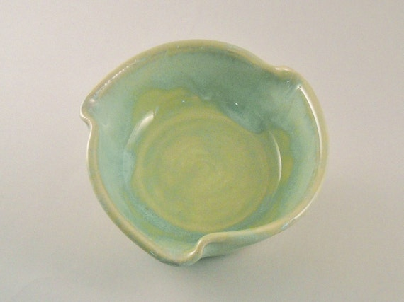 Pretty green and turquoise wave rim bowl.