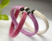 Set of handmade bracelets in pink, lavender, violet