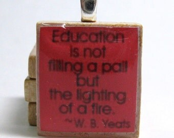 Education is not filling a pail but the lighting of a fire - Yeats quote - red Scrabble tile