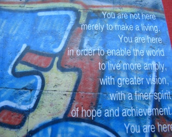 Notepad with Woodrow Wilson quote - You are not here merely to make a living - and Italian graffiti