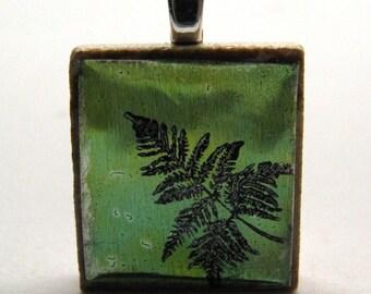 Little green fern - Glowing metallic Scrabble tile pendant