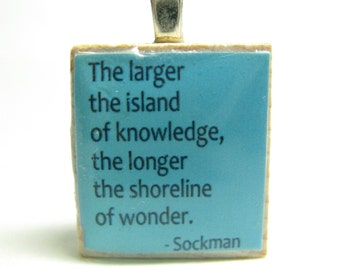 The larger the island of knowledge - turquoise Scrabble tile with Sockman quote