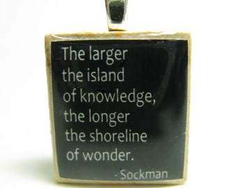 The larger the island of knowledge - black Scrabble tile pendant or charm with Sockman quote - great teacher gift