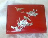 Pretty vintage red lacquer dresser box with mother of pearl inlay