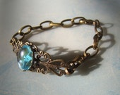 My Blue Heaven antique brass and skyblue cabochon