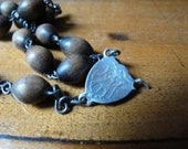 A piece of vintage wooden rosary crow