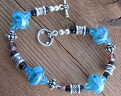 Discounted Lampwork Bracelet Handmade Blue glass with Swarovski crystals