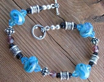 Discounted Lampwork Bracelet Handmade Blue glass with Swarovski crystals