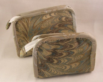 Steel grey and gold cosmetic bags