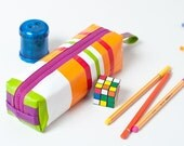 A colorful and playful striped pencil case with orange, green and red stripes
