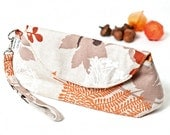 Wristlet Clutch in natural cotton linen printed with orange and white leaves