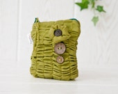 Ruffled zippered pouch in avocado green with wood buttons accent