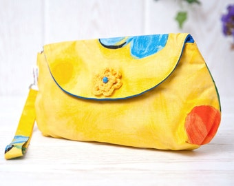 Wristlet Clutch. Yellow cotton with big flowers and a crocheted flower accent