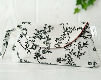 Shabby chic Wristlet Clutch. White cotton with linen optic. Small flowers in black. OOAK