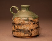 Carved whiskey jug
