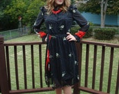 black paisley ruffle sleeved day dress with red stripe detail and white flowers S M
