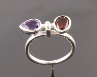 Sterling silver ring set with one 7x5mm pear shape facet Amethyst and 7x5mm oval cut Rhodolite.