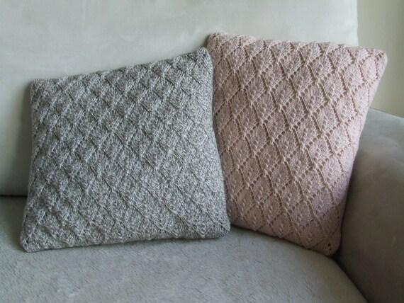 Pale pink diamond pattern hand knitted cushion