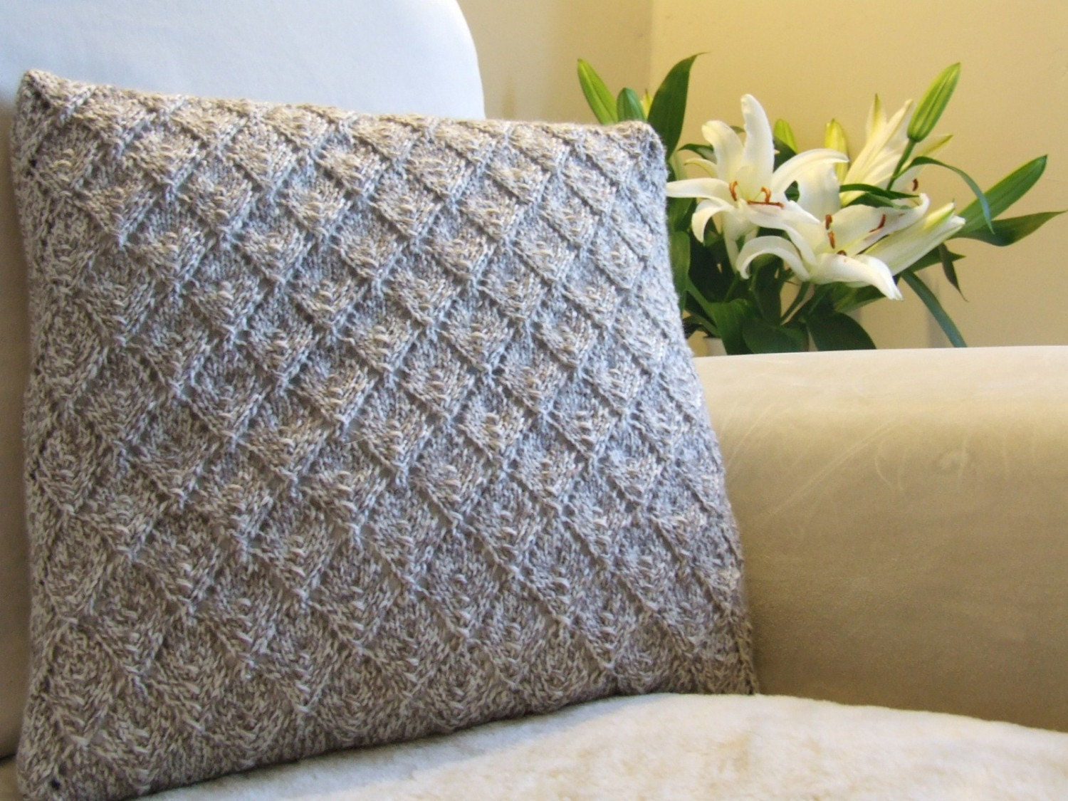 Pale beige and cream diamond pattern hand knitted pillow
