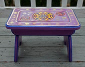 Purple wood stool hand painted with round colorful designs