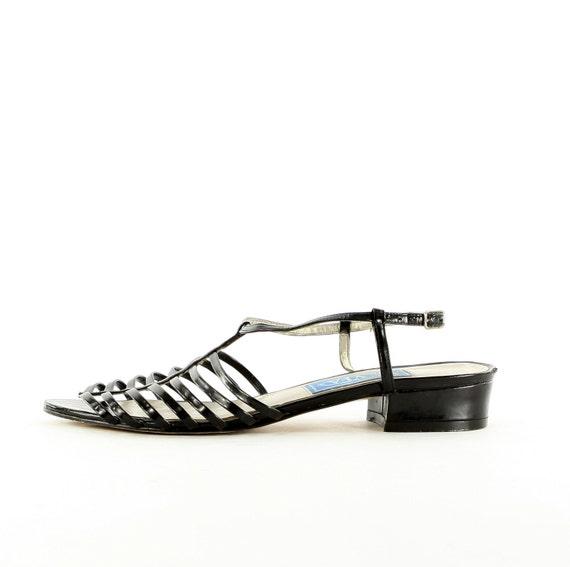 Black patent modern gladiators .short heeled sandals .structured and strappy .Bandolino YFA 7 1/2 N