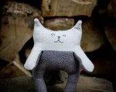 Sleepy, happy kitten made from upcylced, recycled wool sweaters