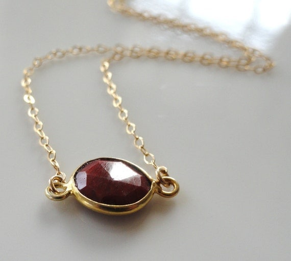 Maribelle   ... small faceted vermeil gold bezel set red ruby necklace.