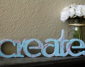 Create wood sign- custom cut wooden word, painted to match your decor