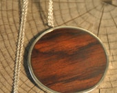 Sterling silver and wood pendant
