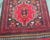 Vivid red Baluchi rug/kilim fromAfghanistan. Hand woven. Heart motifs.