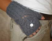 Hand-knitted grey wrist warmers with knitteed flower