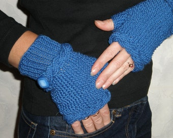 Hand-knitted blue wrist warmers with cables and buttons
