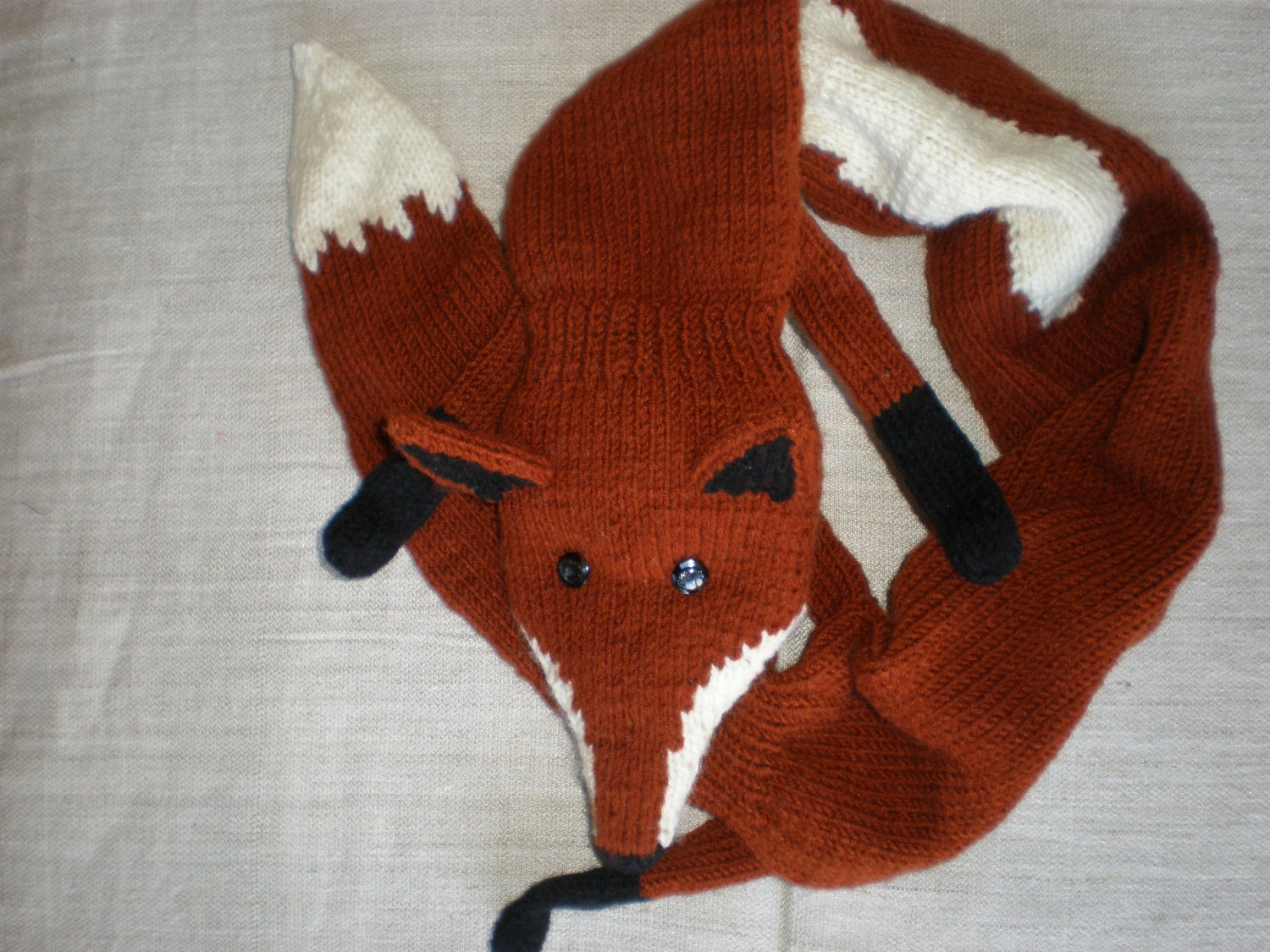 Knitting Pattern Fox Scarf : Hand-knitted reddish brown fox scarf