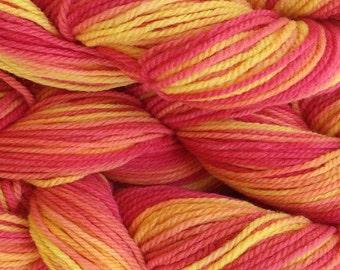Red Orange Pink Yellow Yarn Hand Painted Merino Wool Worsted Weight Yarn in Sunset Red