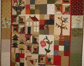darling scrappy sampler quilt.  cluck the chicken.