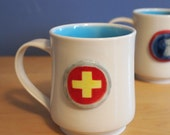 merit badge mug for excellence in first aid