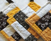Yellow, Brown, and White Quilted Pot Holders