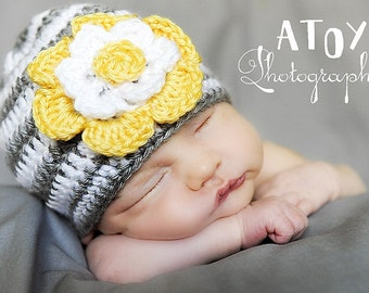 Crocheted  Grey and white stripe baby hat with flower